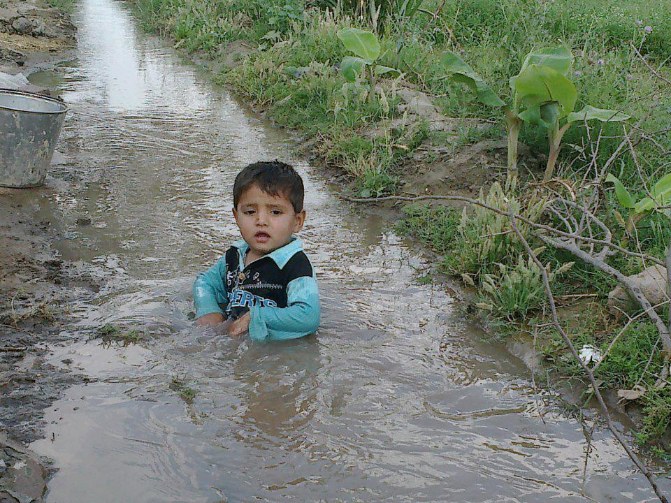 Cute Child in Small Canal canal,Punjab,child